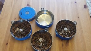 The bowls unlocked and loaded with kibble