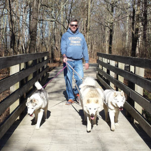 Three pups with Rob on bridge